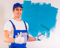 Male repairs indoors Royalty Free Stock Images