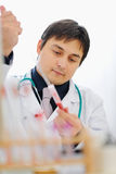 Male researcher working with blood sample royalty free stock photo