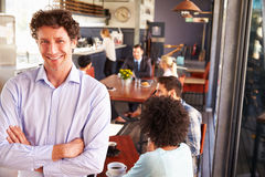 Male restaurant owner, portrait with arms crossed stock photos