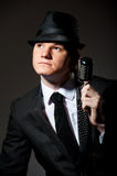 Male with retro microphone. Image showing young male with retro microphone wearing hat Stock Images