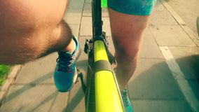 Male rider`s legs. Cycling along city street stock video footage