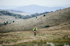 Male riders cyclist rides on a mountain trail mountain bike Stock Photo