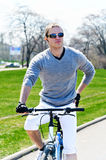 Male riding a bicycle Stock Photography