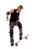 Male riding on skate board Royalty Free Stock Photos