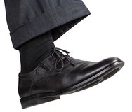 Male right foot in black shoe takes step Royalty Free Stock Photos
