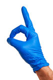 Male right hand in blue latex glove. Royalty Free Stock Photo
