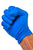Male right hand, fist in blue latex glove. Royalty Free Stock Image