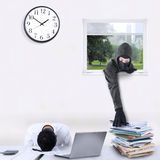 Male robber stealing corporate documents Royalty Free Stock Photo
