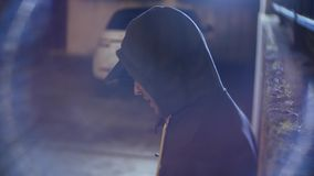 A male robber, threatens a woman and takes her purse, in a dark alley. at night. A male robber, threatens a women and takes her purse, in a dark alley. at night royalty free stock images