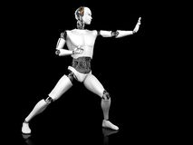 Male robot in fighting karate pose. A male robot standing in a fighting karate pose. Black background Stock Image