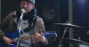 Male rock band performing at musical festival. Conception of music and performance stock footage