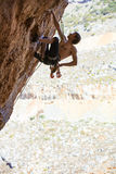 Male rock climber on challenging route on cliff Royalty Free Stock Photography