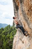 Male rock climber on challenging route on cliff Royalty Free Stock Photos