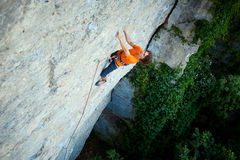 Male rock climber on the cliff Stock Images