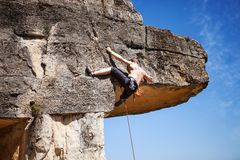 Male rock climber on a cliff Royalty Free Stock Image