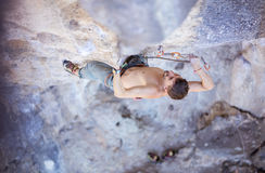 Male rock climber clipping rope Royalty Free Stock Photos