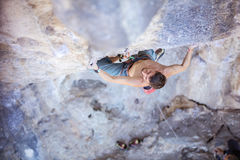 Male rock climber on face of cliff Stock Photo