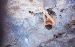 Male rock climber on a face of a cliff Stock Photography