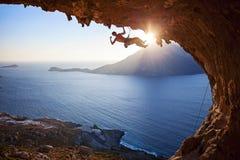 Male rock climber at sunset Stock Photos