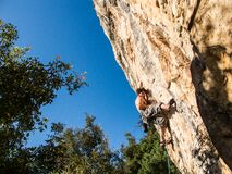 Male Rock Climbing Stock Images