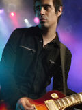 Male Rock Guitarist In Concert royalty free stock images