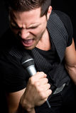Male Rock Star. Sexy male rock star singing Stock Photography