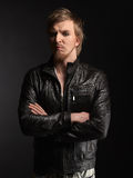 Male rocker and black leather jacket Royalty Free Stock Photography