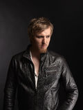 Male rocker and black leather jacket Stock Images