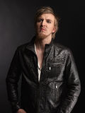 Male rocker and black leather jacket Stock Image