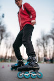 Male roller skater in skates, bottom view. Male rollerskater, extreme sport Royalty Free Stock Images