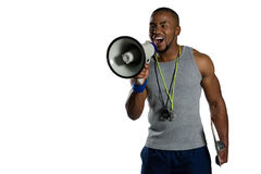 Male rugby instructor announcing on megaphone Stock Image
