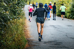 Male runner of average years running marathon. In fall city Park Royalty Free Stock Images