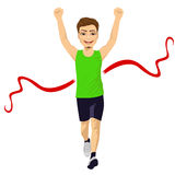 Male runner crossing red finish line. Full body portrait of male runner crossing red finish line and celebrating victory with fists raised up Stock Images