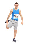 Male runner doing a stretching exercise Royalty Free Stock Images