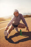 Male runner doing stretching exercise. Royalty Free Stock Photo