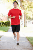 Male Runner Exercising On Suburban Street Royalty Free Stock Images