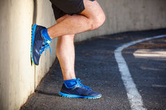 Male runner leaning relaxed. Against wall Royalty Free Stock Image