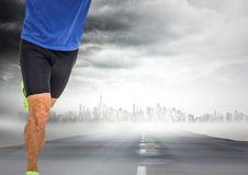 Male runner legs on road with skyline and storm Royalty Free Stock Photography