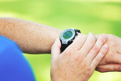 Male runner looking at watch Stock Photos