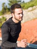 Male Runner in nature after jogging. Portrait Of Male Runner in nature after jogging Royalty Free Stock Images