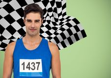 Male runner with number on shirt against green background and checkered flag. Digital composite of Male runner with number on shirt against green background and Stock Image