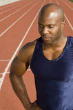 Male Runner At Racing Track. African American male runner at racing track Stock Image
