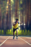Male runner sprinting during outdoors training on nature. Young male runner sprinting during outdoors training on nature Stock Images