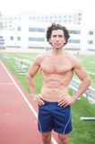 Male runner in stadium. Athetlic muscular male runner standing in a stadium Royalty Free Stock Photo