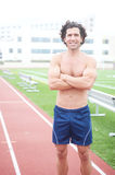 Male runner in stadium. Athetlic muscular male runner standing in a stadium Stock Photos