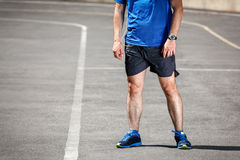 Male runner standing. On racing track after workout Stock Image