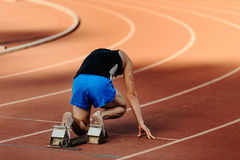 Male runner starting blocks. Of 400-meter sprint at competition Royalty Free Stock Photography