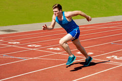 Male runner on starting blocks Stock Images