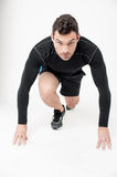 Male runner in starting position Royalty Free Stock Image