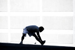 Male runner stretching before a run. Royalty Free Stock Images